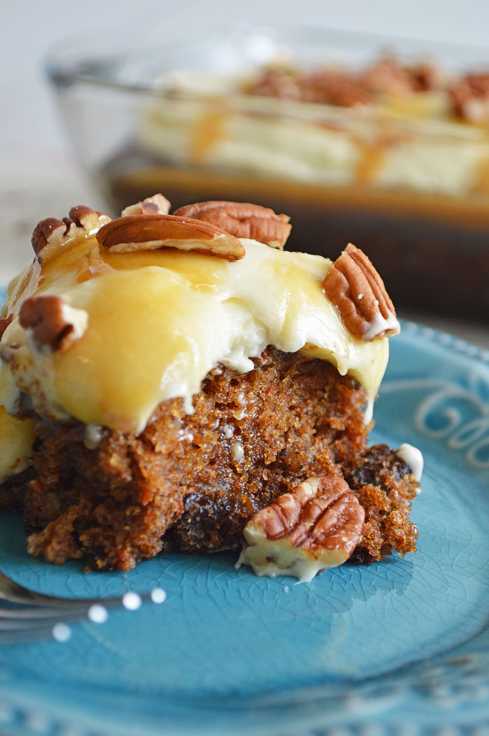 Caramel Carrot Cake Poke Cake with Maple Cream Cheese Frosting