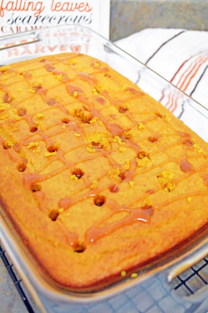 pumpkin poke cake filled with caramel sauce